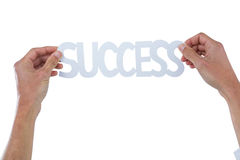 Hand holding success word. Against white background Royalty Free Stock Image