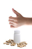 Hand holding supplements or vitamin bottle Royalty Free Stock Images