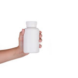 Hand holding supplements or vitamin bottle. On white isolated background Royalty Free Stock Photo