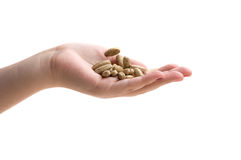 Hand holding supplements or vitamins. On white isolated background Stock Photo