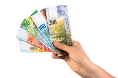 Hand holding swiss franc banknotes Stock Image