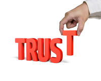 Hand holding T and putting Trust word together Stock Photo