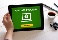 Hand holding tablet with affiliate program concept on screen. Hand holding digital tablet computer with affiliate program concept on screen. All screen content Stock Photo