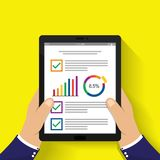 Hand holding tablet. businessman read financial analysis report. With  chart and graph. flat design for business concept Vector illustration Royalty Free Stock Image