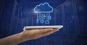 Hand holding tablet with cloud icon and hanging connection devices and technology background. Digital composite of Hand holding tablet with cloud icon and Stock Photos