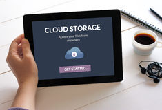 Hand holding tablet with cloud storage app concept on screen Royalty Free Stock Photos