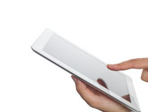 Hand holding tablet computer. Man using tablet computer with his hand in white blank background Stock Image