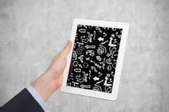 Hand holding Tablet. Computer with arrows Stock Photo