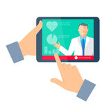 Hand holding a tablet computer with doctor online. Royalty Free Stock Images