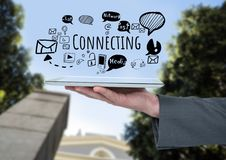 Hand holding tablet and Connecting text with social media drawings graphics Stock Image