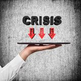 Hand holding tablet with crisis Royalty Free Stock Images