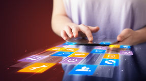Hand holding tablet device with media application Royalty Free Stock Photo