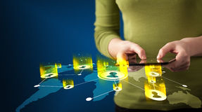 Hand holding tablet device with social network map. Concept on background Stock Image