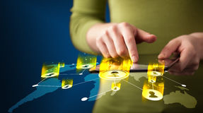 Hand holding tablet device with social network map. Concept on background Stock Photography