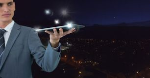Hand holding tablet with glow Royalty Free Stock Photo