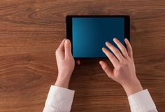 Hand holding tablet with linked graphs and charts concept. Hand using tablet with linking graphs charts  report and informational flow conceptn royalty free stock photography