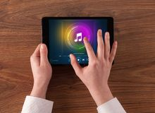 Hand holding tablet with music play concept. Hand touching tablet with music play  conceptn stock photography