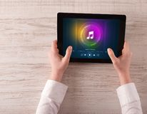 Hand holding tablet with music play concept. Hand touching tablet with music play  concept royalty free stock photos