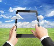 Hand holding tablet Stock Photos