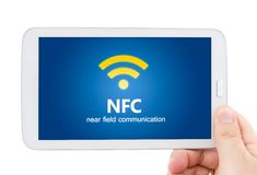 Hand holding tablet with NFC technology Royalty Free Stock Photo