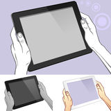 Hand Holding A Tablet And PAD Royalty Free Stock Images