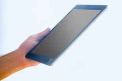 Hand holding a tablet pc Stock Photo
