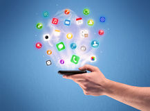 Hand holding tablet phone with app icons Royalty Free Stock Image
