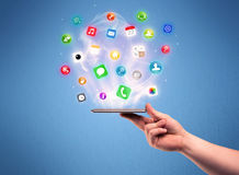 Hand holding tablet phone with app icons Royalty Free Stock Photography