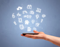 Hand holding tablet phone with drawn icons Royalty Free Stock Photos