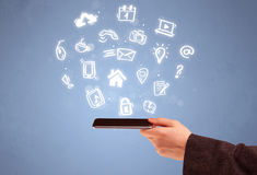 Hand holding tablet phone with drawn icons Royalty Free Stock Photo