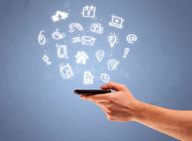 Hand holding tablet phone with drawn icons Stock Image