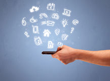 Hand holding tablet phone with drawn icons Royalty Free Stock Images