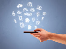 Hand holding tablet phone with drawn icons Royalty Free Stock Photography