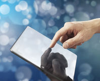 Hand holding tablet Stock Images