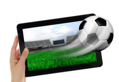 Hand holding tablet with soccer ball Royalty Free Stock Image