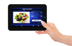 Hand holding tablet with takeaway restaurant order screen. Isolated over white background Stock Photos