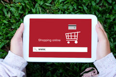 Hand holding tablet with www. on search bar screen background Royalty Free Stock Photos