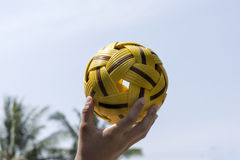 Hand Holding a Takraw Ball. With Blue Sky Background Stock Photography