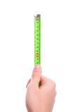 Hand holding tape-measure Royalty Free Stock Photography