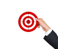 Hand holding target. On a white background Stock Photos