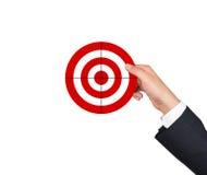 Hand holding target Stock Photos