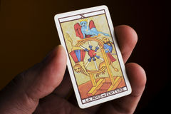 Hand holding tarot card Royalty Free Stock Photography
