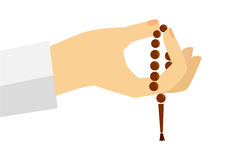 Hand - Holding Tasbih (islam prayer beads) Royalty Free Stock Photo