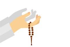 Hand - Holding Tasbih (islam prayer beads) Stock Image