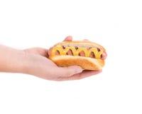 Hand holding tasty hot dog. Royalty Free Stock Photography