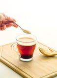 Hand holding teaspoon full of sugar Stock Photo