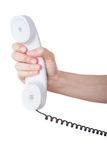Hand holding a telephone isolated stock photography