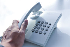Hand holding telephone receiver. Royalty Free Stock Image