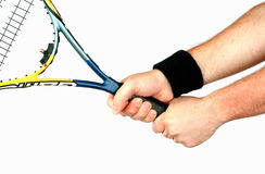 Hand holding tennis racket Stock Photo