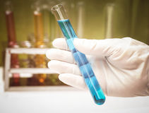 Hand holding a test tube Royalty Free Stock Photos